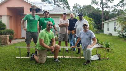 The Coastal Disaster Relief Team tarping roofs after Hurricane Irma