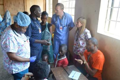 Ugandan doctors working side by side with our volunteers